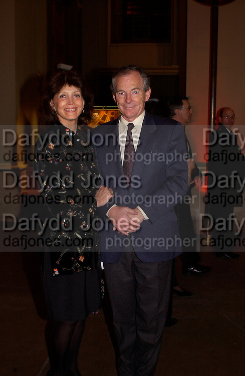 Mr. and Mrs. Simon Jenkins, British Museum 250th Anniversary party, 15 December 2003. © Copyright Photograph by Dafydd Jones 66 Stockwell Park Rd. London SW9 0DA Tel 020 7733 0108 www.dafjones.com