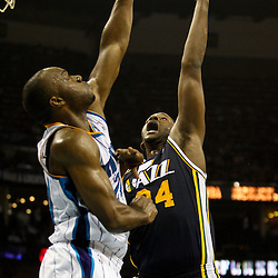 April 11, 2011; New Orleans, LA, USA; Utah Jazz power forward Paul Millsap (24) shoots over New Orleans Hornets power forward Carl Landry (24) during the first half at the New Orleans Arena.  Mandatory Credit: Derick E. Hingle