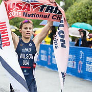 Triathletes celebrates winning finish