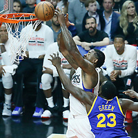07 December 2016: Golden State Warriors forward Draymond Green (23) fouls LA Clippers center DeAndre Jordan (6) during the Golden State Warriors 115-98 victory over the Los Angeles Clippers, at the Staples Center, Los Angeles, California, USA.