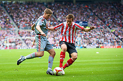SUNDERLAND, ENGLAND - Saturday, August 16, 2008: Liverpool's captain Steven Gerrard MBE and Sunderland's Dean Whitehead during the opening Premiership match of the season at the Stadium of Light. (Photo by David Rawcliffe/Propaganda)