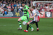 Forest Green Rovers Chris Clements(22) and Cheltenham Town's Joe Morrell(25) challenge for the ball during the EFL Sky Bet League 2 match between Cheltenham Town and Forest Green Rovers at LCI Rail Stadium, Cheltenham, England on 14 April 2018. Picture by Shane Healey.
