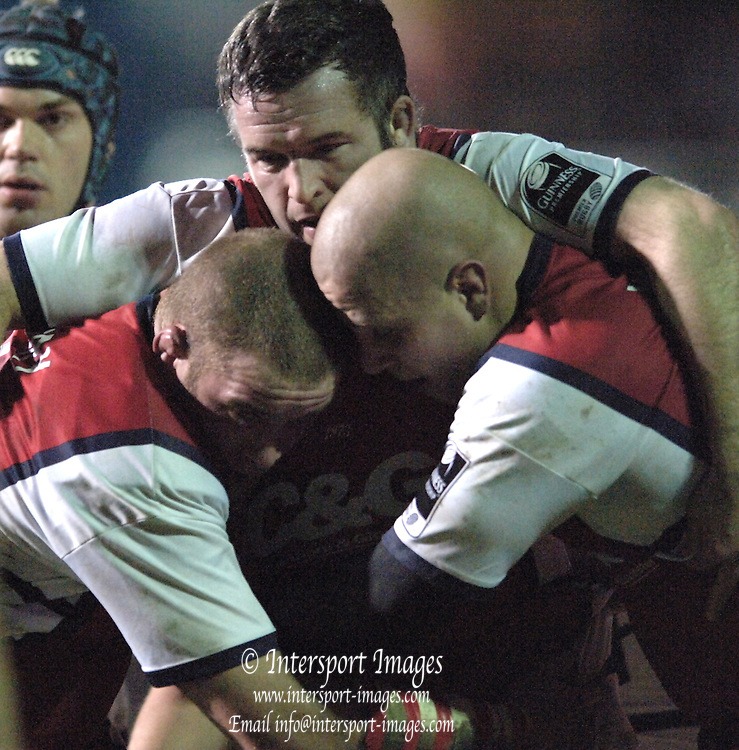 2005/06 Powergen Cup, Bath Rugby vs Gloucester Rugby, Gloucester front row, Hooker [centre] Mefin Davies pull's in his props' left,  Phil Vickery and Nick Wood. at The Rec, on the 03.12.2005.   © Peter Spurrier/Intersport Images - email images@intersport-images..