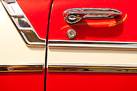 Red and white door panel, shining chrome trim 1954 Chevrolet