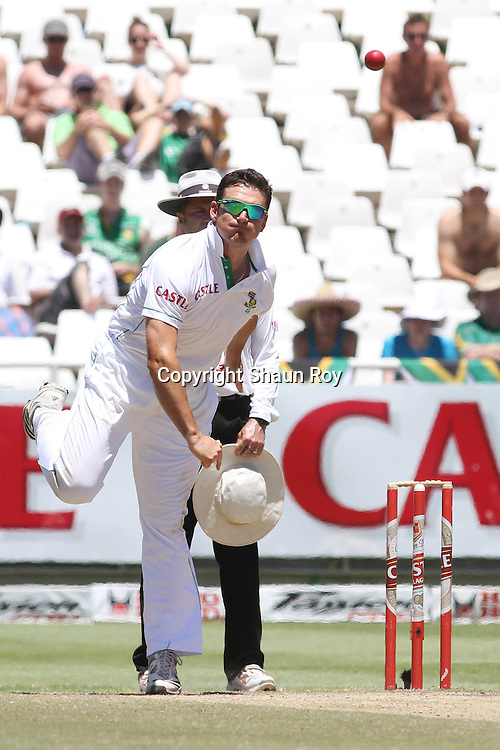CAPE TOWN, SOUTH AFRICA - 6 January 2011, South African captain Graeme Smith sends down a delivery during day 5 of the 3rd Castle Test between South Africa and India held at Sahara Park Newlands Stadium in Cape Town, South Africa on the 6 January 2011 .Photo by: Shaun Roy