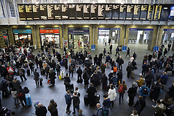 © Licensed to London News Pictures. 23/12/2016. London, UK. Passengers wait for trains at King's Cross station. The Christmas getaway begins  today with<br />