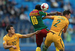 June 22, 2017 - Saint Petersburg, Russia - Trent Sainsbury (L), Milos Degenek of the Australia national football team and Vincent Aboubakar (C) of the Cameroon national football team vie for the ball during the 2017 FIFA Confederations Cup match, first stage - Group B between Cameroon and Australia at Saint Petersburg Stadium on June 22, 2017 in St. Petersburg, Russia. (Credit Image: © Igor Russak/NurPhoto via ZUMA Press)