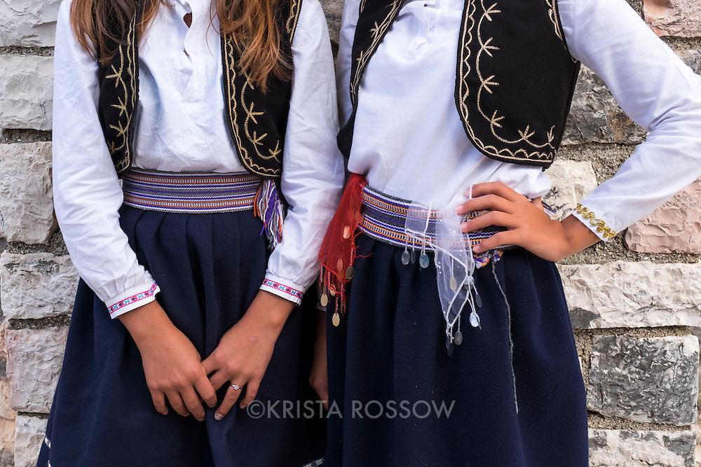 "Two young female Albanian folk performers from the cultural ensemble ""Zeri i Bilbilit"" at Lekursi Castle (Lëkurësi Castle) in Sarande, Albania."