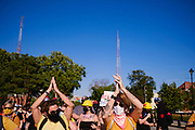 """28 JULY 2020 - DES MOINES, IOWA: Members of Des Moines' """"Wall of Moms"""" chant while they lead a march up Grand Ave to the Governor's Mansion in Des Moines. About 150 supporters of Black Lives Matter marched from downtown to Des Moines to the Governor's Mansion. They were demanding that Iowa Governor Kim Reynolds restore the voting rights for felons who have completed their sentence. In June, Reynolds met with representatives of Black Lives Matter and promised to sign an executive order to restore voting rights, but she hasn't said anything more about it in six weeks. Iowa is now the only state in the US that permanently strips felons of their voting rights. That means 60,000 people in Iowa can't vote.     PHOTO BY JACK KURTZ"""