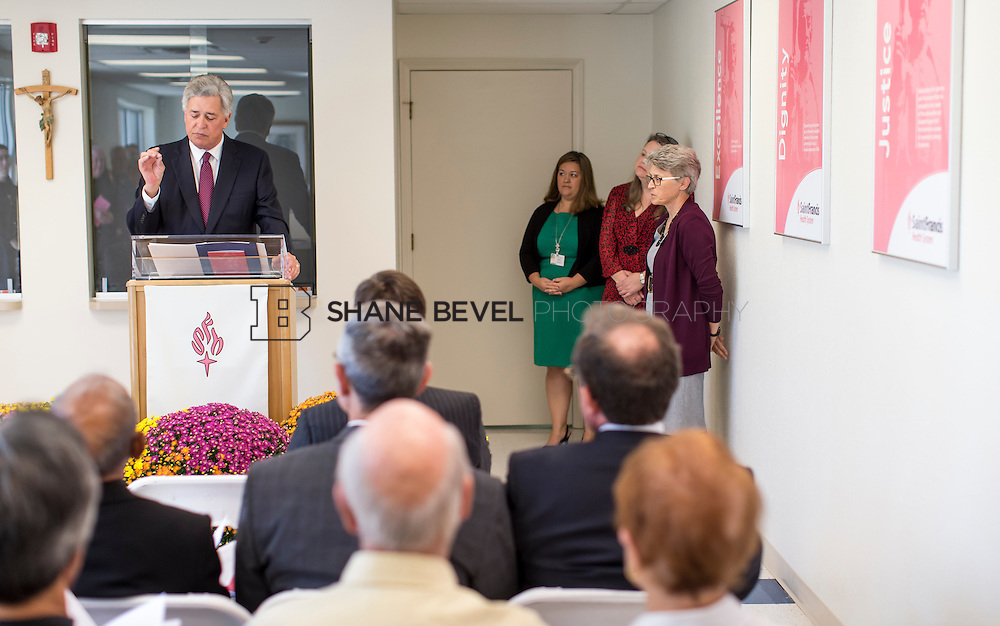 9/29/16 4:03:57 PM --  Bishop David Konderla blesses the newly remodeled Xavier Clinic in east Tulsa. <br /> <br /> Photo by Shane Bevel