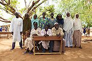 Members of the parent teacher association (PTA) at Pope John.s Catholic Junior High School, northern Ghana. All members were encouraged by the chief to make a desk and bring it to school.