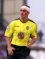 Gavin McCann (Aston Villa) with a cut head. Portsmouth v Aston Villa. 16/8/2003. Credit : Colorsport/Andrew Cowie.