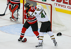 Oct 22, 2008; Newark, NJ, USA; New Jersey Devils defenseman Bryce Salvador (24) and Dallas Stars right wing B.J. Crombeen (44) fight during the third period at the Prudential Center. The Devils defeated the Stars 5-0.