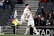 Milton Keynes Dons forward Rhys Healey (10) scores a goal and celebrates  with Milton Keynes Dons defender George Williams (2) 1-0 during the EFL Sky Bet League 1 match between Milton Keynes Dons and Wycombe Wanderers at stadium:mk, Milton Keynes, England on 1 February 2020.