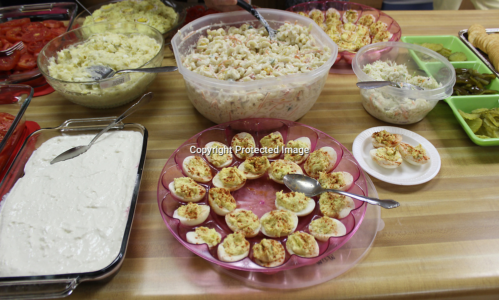 Deviled eggs, pasta, potato salad and fresh pickles and tomatoes were among several food choices.