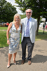 CHRIS & JANICE WRIGHT at the 2014 Glorious Goodwood Racing Festival at Goodwood racecourse, West Sussex on 31st July 2014.