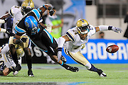 Hartford Colonials defensive back Emanuel Cook (24) breaks up a pass intended for Florida Tuskers wide receiver Maurice Price (17) at the Florida Citrus Bowl on November 11, 2010 in Orlando, Florida. The Tuskers won the game 41-7..©2010 Scott A. Miller