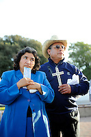 """Margarita Rios, left, and her husband Gregorio, from Seaside at a somber dedication ceremony on Sunday in Closter Park. The group """"A Time for Grieving and Healing"""" unveiled a memorial to victims of violence in Monterey County. Their nephew, Juan Guillen, of Salinas, was one."""