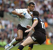 Twickenham, GREAT BRITAIN, 2004 Heineken Cup Final. Toulouse wing Emile Ntamack evades Tom Voyce's tackle, during the  London London Wasps v Toulouse, final at Twickenham on  23/05/2004  [Credit Peter Spurrier/Intersport Images]   [Mandatory Credit, Peter Spurier/ Intersport Images].