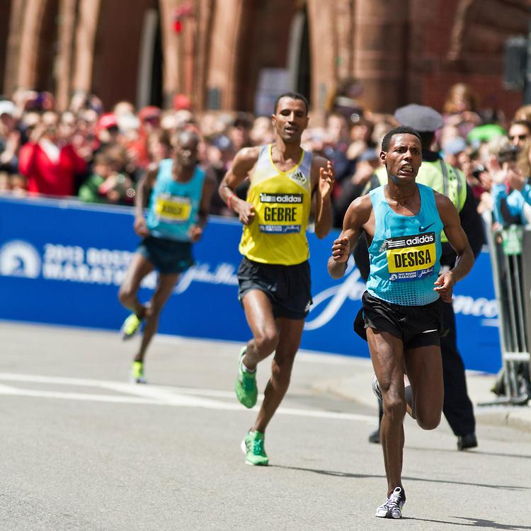 2013 Boston Marathon: eventual winner Lilesa Desisa, Ethiopia, turns onto Boylston with quarter mile to go