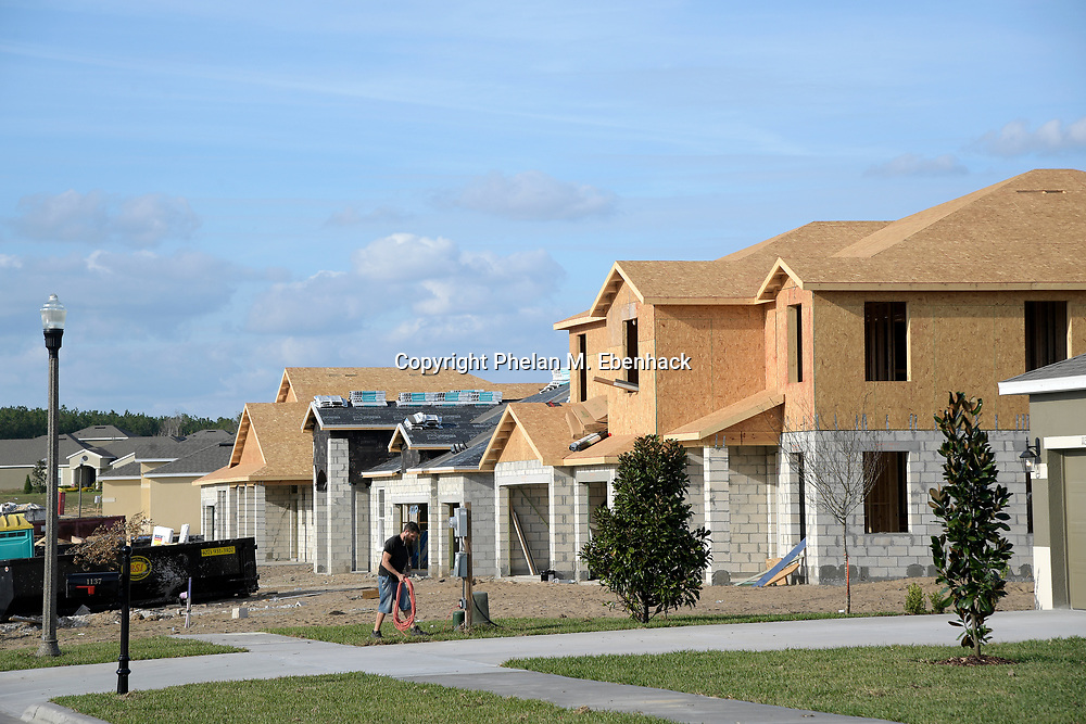 New homes built by D.R. Horton stand for sale at the Rock Springs Ridge subdivision, Wednesday, Jan. 18, 2017, in Apopka, Fla. (Photo by Phelan M. Ebenhack)