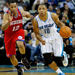 January 4, 2012; New Orleans, LA, USA; New Orleans Hornets shooting guard Eric Gordon (10) drives past Philadelphia 76ers shooting guard Evan Turner (12) during the second quarter of a game at the New Orleans Arena.   Mandatory Credit: Derick E. Hingle-US PRESSWIRE