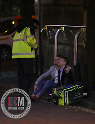 Manchester UK  24.12.2016: Images from Manchesters Gay Village during the Mad Friday celebrations this on the 23 and 24th of December,<br /> <br /> A man is helped by the ambulance service