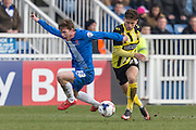 Hartlepool United striker Luke James and Matty Cash (Midfielder) Dagenham & Redbridge compete for the ball during the Sky Bet League 2 match between Hartlepool United and Dagenham and Redbridge at Victoria Park, Hartlepool, England on 12 March 2016. Photo by George Ledger.