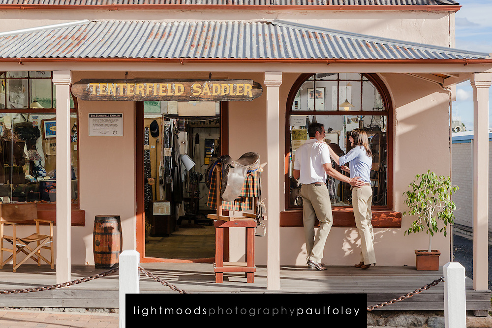 Couple window shopping at the Tenterfield Saddler, New England, NSW, Australia.