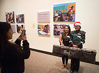 Anahi Alicibar of LIFE poses for a photo with Estefania Morales of the Alisal Community Arts Network at the December 5th, 2017 opening of the Stories from Salinas exhibition at the CSUMB Salinas Center for Arts and Culture in Oldtown. The exhibition celebrates the mentors, youth and families of the Salinas Youth Initiative.