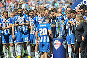 Wigan Defender Craig Morgan (CAPT) takes centre stage ready to lift the League One trophy after the Sky Bet League 1 match between Wigan Athletic and Barnsley at the DW Stadium, Wigan, England on 8 May 2016. Photo by John Marfleet.
