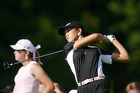 August 21, 2004; Dublin, OH, USA;  14 year old amateur Michelle Wie tees off at the 16th hole while fellow amateur Paula Creamer looks on during the 3rd round of the Wendy's Championship for Children golf tournament held at Tartan Fields Golf Club.  <br />Mandatory Credit: Photo by Darrell Miho <br />&copy; Copyright Darrell Miho