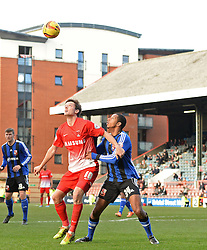 Orient's David Mooney and Swindon's Jamie Reckord  compete for the ball - Photo mandatory by-line: Mitchell Gunn/JMP - Tel: Mobile: 07966 386802 22/02/2014 - SPORT - FOOTBALL - Brisbane Road - Leyton - Leyton Orient V Swindon Town - League One
