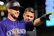 Apr 29, 2016; Phoenix, AZ, USA; Colorado Rockies left fielder Ryan Raburn (6) smiles and points to the dugout after being hit by a pitch in the eighth inning of the game against the Arizona Diamondbacks at Chase Field. Mandatory Credit: Jennifer Stewart-USA TODAY Sports