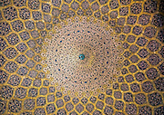 Stunning photographs reveal the beautiful ceilings in Iran's mosques, bazaars and public baths<br /> <br /> For the past few decades, restrictions on travel to Iran has meant the country has been largely shut off from the Western world, but as visa sanctions are lifted in the light of a landmark nuclear deal, the local tourism industry is hoping for a flurry of visitors.<br /> It's not hard to see why Iran is listed as one of the top travel destinations of 2016, with its rich culture and history. <br /> Among the standout aspects of the nation is its beautiful ancient architecture, with the cities and towns littered with ornate and eye-catching mosques, public baths and markets. <br /> And unlike many other countries - the roof is not an afterthought, with many ceilings built as the centrepiece to the building, with many of the tile designs showcasing a display of intricate geometric patterns that date back several centuries. <br /> French photographer Eric Lafforgue has travelled the country photographing the ceilings of indoor markets, mosques and bath houses. <br /> <br /> Photo shows: The ceiling of the dome in Sheikh Lotfollah Mosque. The construction of the ceiling started in 1603 and the decoration seems to lead the eye upwards toward its centre, as the rings of ornamental bands filled with Arabesque patterns become smaller and smaller