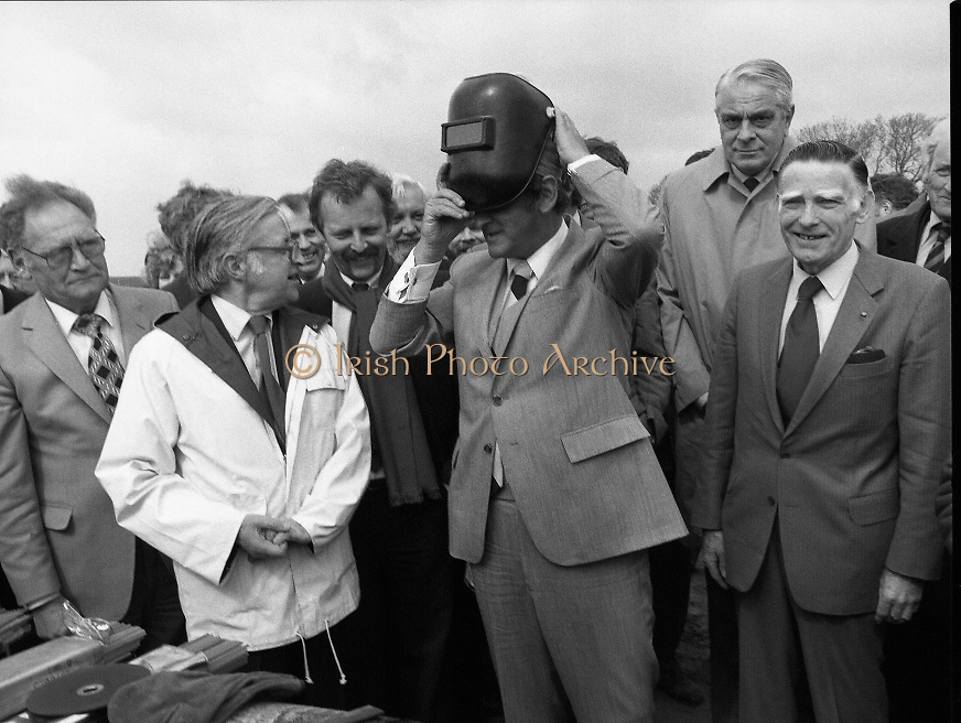 Cork / Dublin Gas Pipeline.28.04.1982.04.28.1982.28th April 1982.1982...At Brownbarn,Kingswood,Dublin the Minister for Industry and Energy, Mr Albert Reynolds T.D. performed the ceremonial first weld to officially start the project..After cleaning the weld area the Minister prepares to weld.