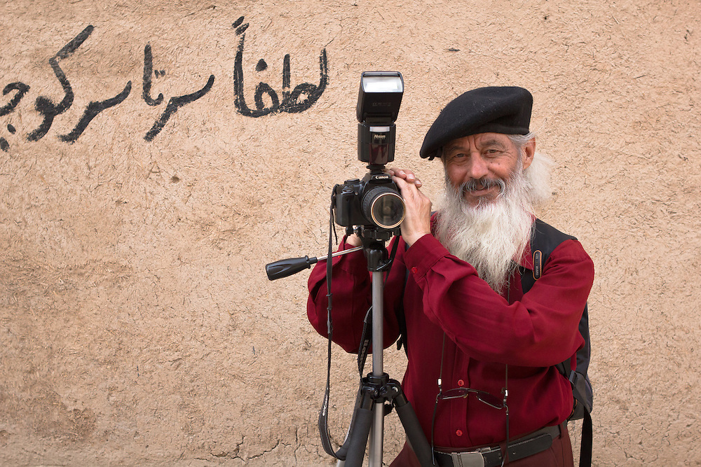 Mohammad (74) is a retired English teacher. He earns a little extra as a self-made street photographer, taking portrait shots of local tourists in Yazd, Iran. His small backpack contains a portable printer, enabling him to deliver prints on the spot.