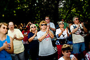 Audience members clap during the 'Restoring Honor' event at the Lincoln Memorial on August 28, 2010 in Washington, DC.