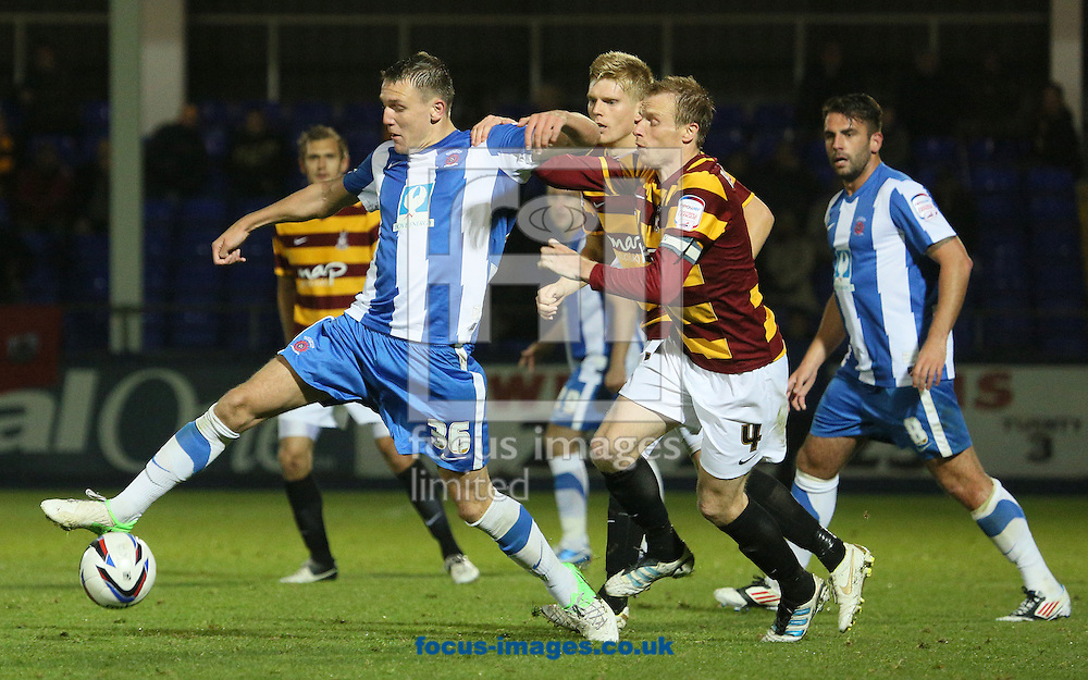 Picture by Paul  Gaythorpe/Focus Images Ltd +447771 871632.09/10/2012.Charlie Wyke of Hartlepool United and Ricky Ravenhill of Bradford City during the Johnstone's Paint Trophy match at Victoria Park, Hartlepool.