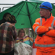 Day two of the Rolling Resistance, Preston New Road, Lancashire. Michelle Martin was part of a 13 strong lock-on the day before. Everyone else were cut free by specialist proterster removal teams the day before but because the police ran out of time Michelle managed to stay on.  By the time of being photographed Michelle has been in this spot locked on for 27.5 hours. She lasted 35.5hours before she was cut loose by a specialist protester removal team.The New Preston Road Quadrilla site is almost ready to start drilling for shale gas after many delays caused by local objections. Lancashire County council voted against fracking but the conservative central government forced it through.