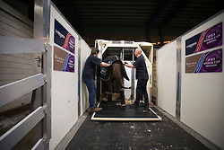 Glock's Flirt being lead in the flying stalls by her grooom Anna Visser <br /> Departure of the horses to the World Cup Finals in Las Vegas from Schiphol - Amsterdam 2015.<br />  © Hippo Foto - Dirk Caremans