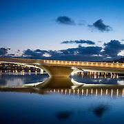 6 desember 2014. 18 dager til julaften. Den nye gang og sykkelbroa til konserthuset Buen i Mandal koser seg i solnedgangen.<br /> <br /> December 6 2014 18 days until christmas eve. In Mandal the new bridge to the concert house Buen are enjoying the sunset.
