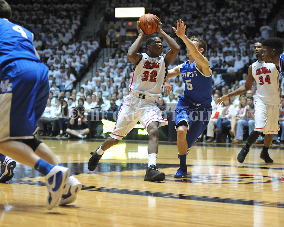 """Ole Miss' Jarvis Summers (32) vs. Kentucky's Jarrod Polson (5) at the C.M. """"Tad"""" Smith Coliseum on Tuesday, January 29, 2013."""