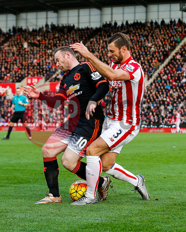 Wayne Rooney of Manchester United is challenged by Erik Pieters of Stoke City - Mandatory byline: Rogan Thomson/JMP - 26/12/2015 - FOOTBALL - Britannia Stadium - Stoke, England - Stoke City v Manchester United - Barclays Premier League - Boxing Day Fixture.