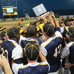 Staff photos by Tom Kelly IV<br /> Devon Prep players hold up the trophy following the Devon Prep vs Elk County Catholic in the PIAA single A Championship game in State College on Friday afternoon, June 13, 2014 due to a rain storm moving through.