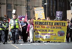 Licensed to London News Pictures. 25/05/2013. Newcastle upon Tyne, UK. Over a thousand supporters of the EDL congregate and hold a protest march in Newcastle upon Tyne, countered by a march held by Newcastle Unites, a collection of groups opposed to the EDL. A heavy police presence kept the groups separated. Photo credit: Adrian Don/LNP