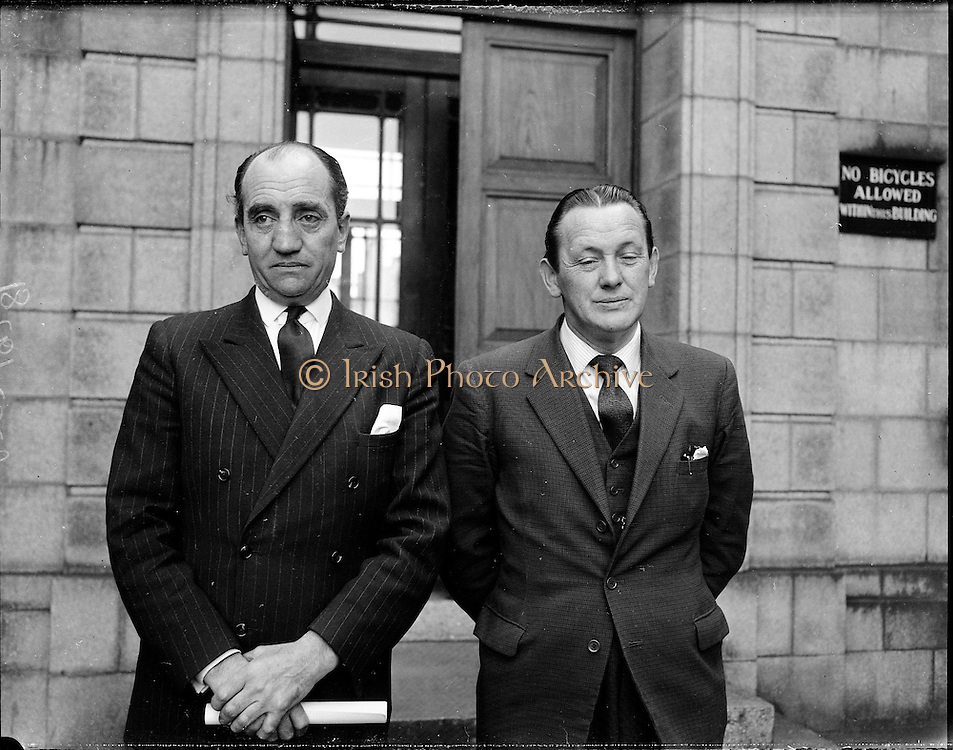 District Justices, Desmond O'Hagan, Co. Louth, and Kevin McCourt, Co. Cork, are sworn in..24.03.1961