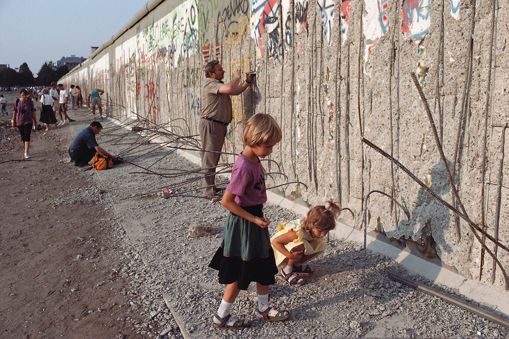 In the spring of 1990, the Berlin Wall was a tourist destination before it was completely dismantled. People used hammers and chisels to take pieces for souvenirs. Germany.