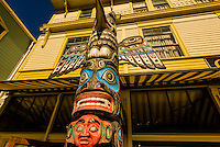 A totem pole on the main street, Broadway, in the Klondike Gold Rush National Historical Park, Skagway, Inside Passage, southeast Alaska USA.