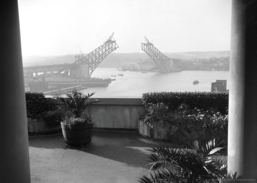 View Over Sydney Harbour Showing the two sections of the New Bridge, Sydney, Australia, 1930